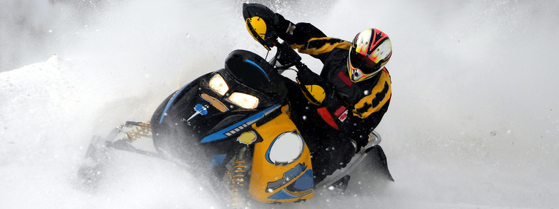 ACTIVE / LATVIA / SNOWMOBILE IN TRACK